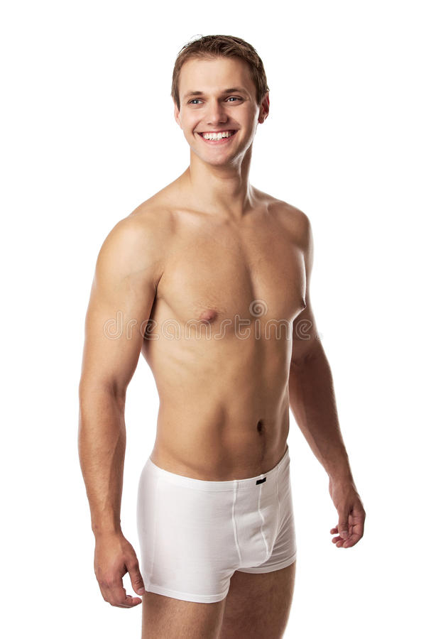 Handsome young man in underwear against white stock photography