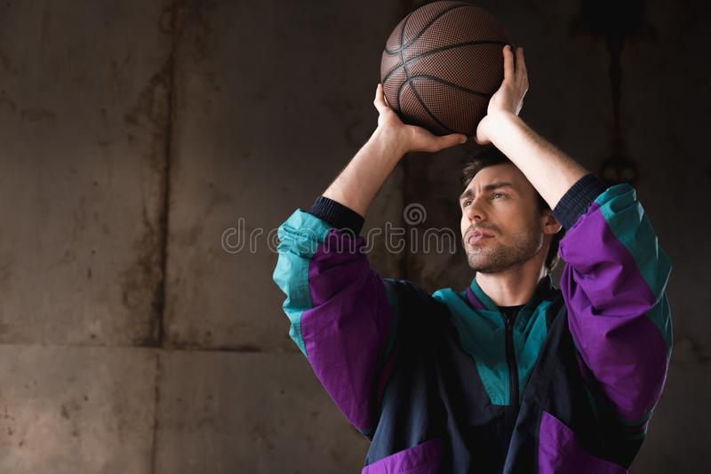 handsome young man in vintage windcheater throwing stock photo
