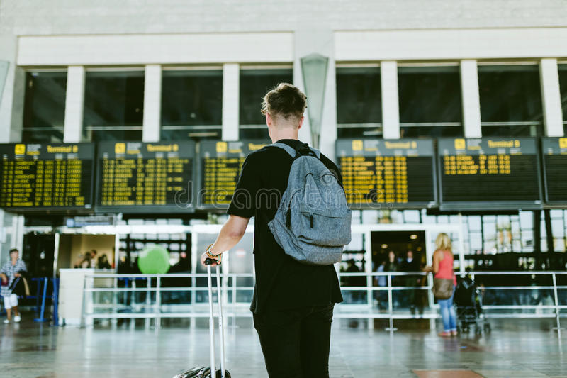 Handsome young man walking in the airport. stock photography