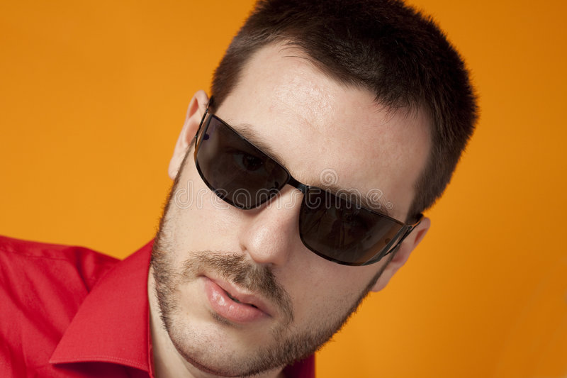 Handsome young man wearing sunglasses stock images