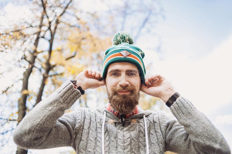 Handsome young man wearing warm clothes outdoors portrait royalty free stock image