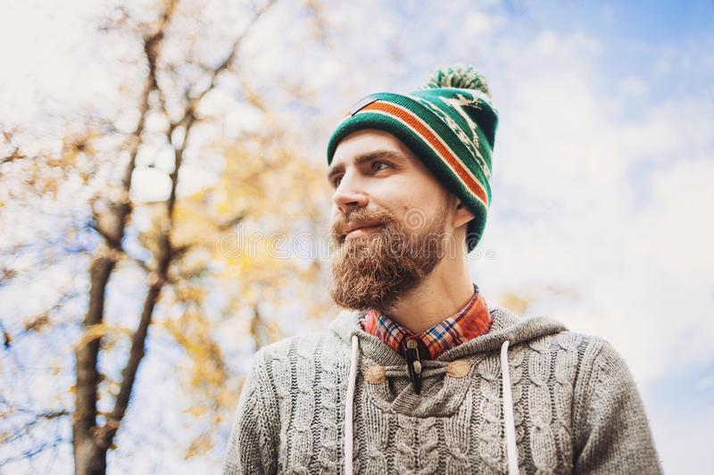 Handsome young man wearing warm clothes outdoors portrait royalty free stock photos