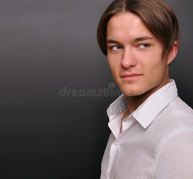 Stylish young man, smiling. Male model. royalty free stock image