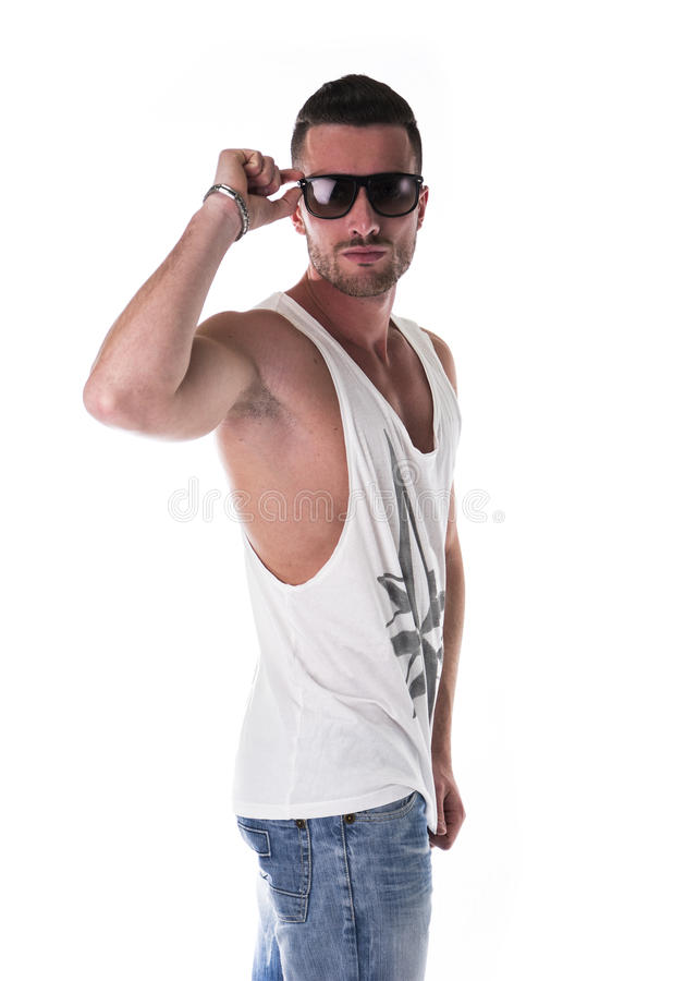 Handsome young man in white tanktop and sunglasses royalty free stock photos