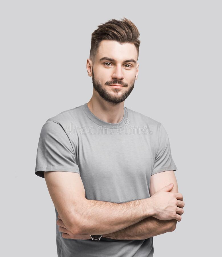 Free Handsome Young Man With Folded Arms Isolated Portrait. Joyful Cheerful Smiling  Men With Crossed Hands Studio Shot Royalty Free Stock Images - 182114509
