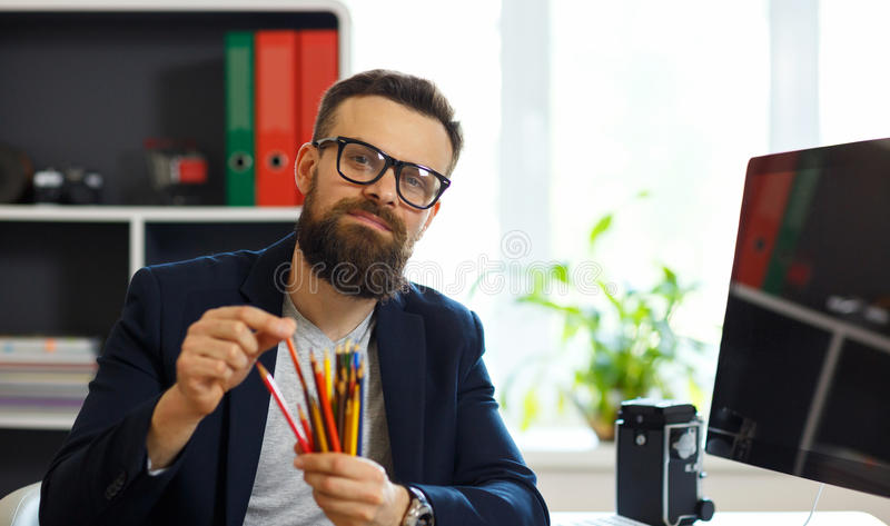 Handsome young man working from home office stock image
