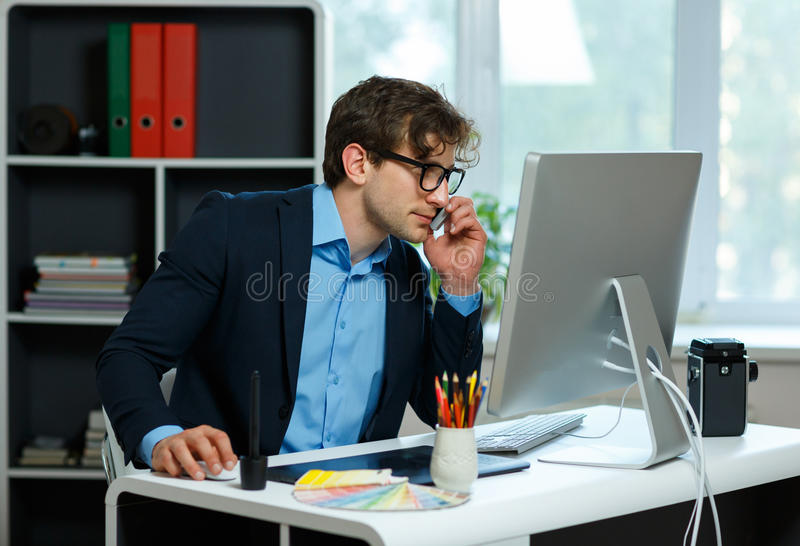 Handsome young man working from home office. Modern business concept royalty free stock photos