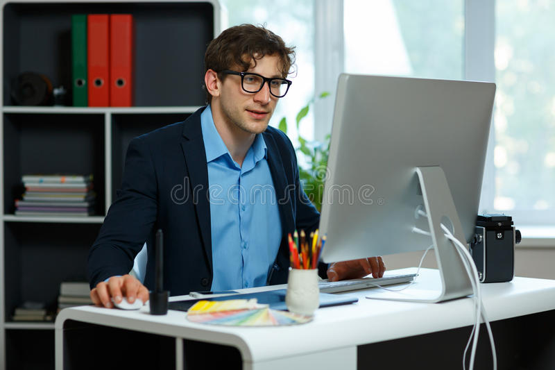 Handsome young man working from home office royalty free stock photo