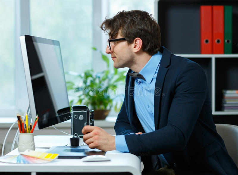 Handsome young man working from home office royalty free stock photos