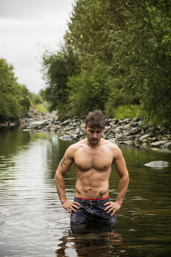 Attractive Young Muscleman In Water Pond Stock Photography
