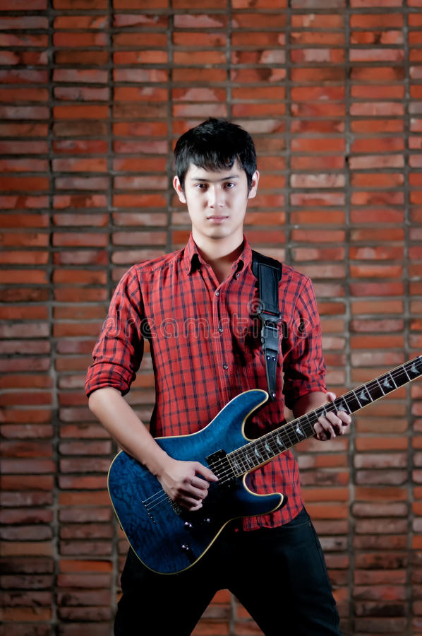 Download Handsome Young Musician Playing The Guitar Royalty Free Stock Image - Image: 25572216