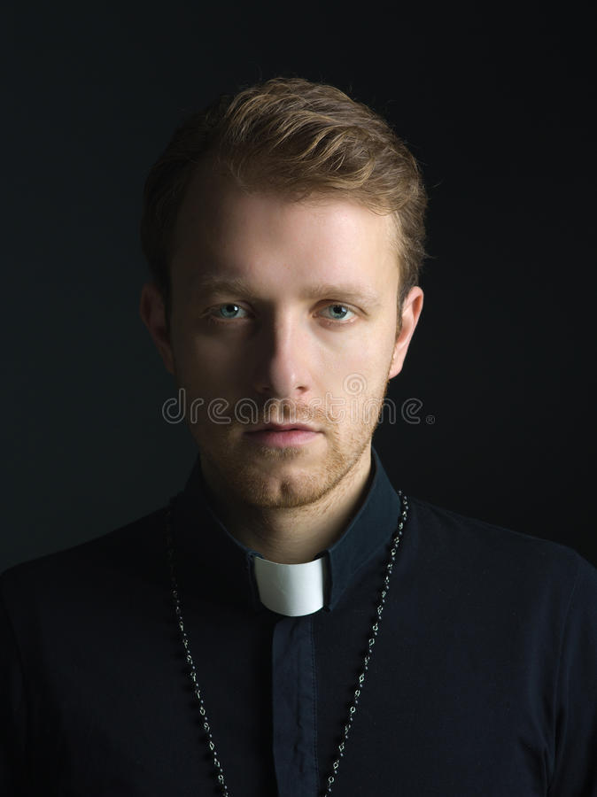 Handsome young priest stock images