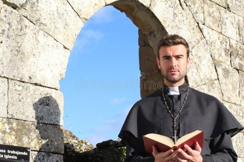 Handsome young priest close up royalty free stock photo