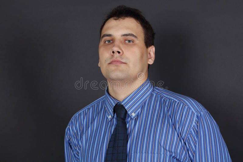 Handsome young serious man in tie stock photography