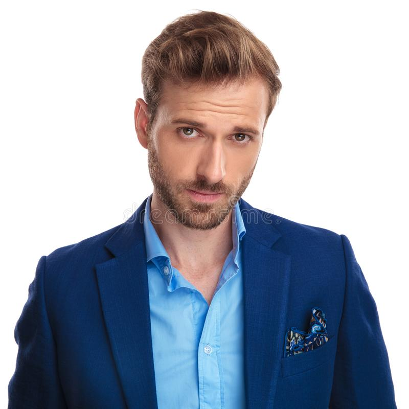 Handsome young smart casual man with a smug look royalty free stock photo