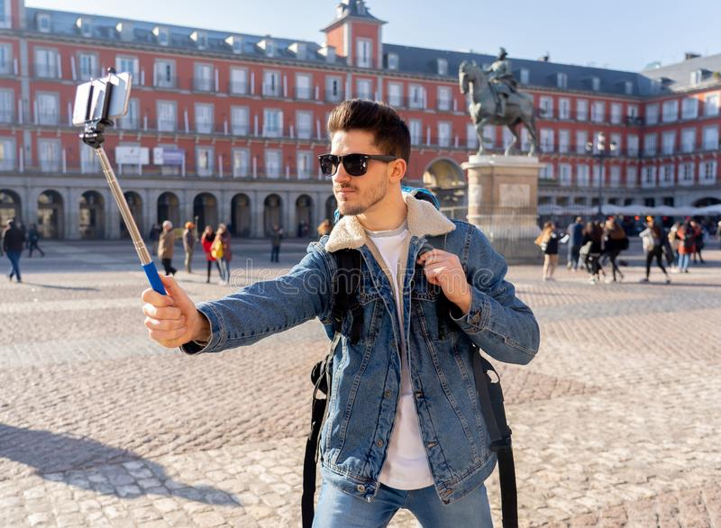 Handsome young student tourist man happy and excited taking a se stock image