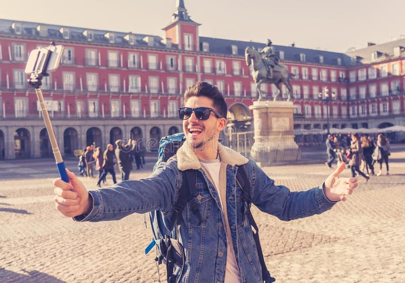 Handsome young student tourist man happy and excited taking a se stock photo