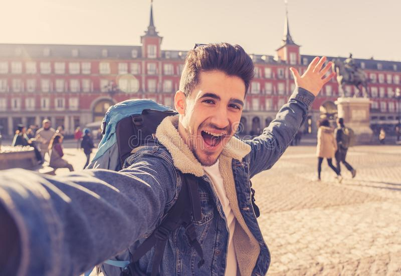 Handsome young student tourist man happy and excited taking a selfie in Madrid, Spain stock images