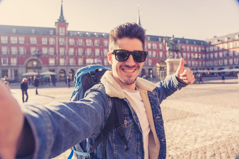 Handsome young student tourist man happy and excited taking a selfie in Madrid, Spain royalty free stock photography