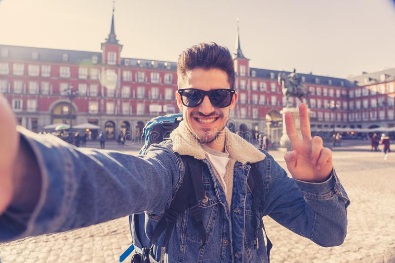 Handsome young student tourist man happy and excited taking a selfie in Madrid, Spain royalty free stock images