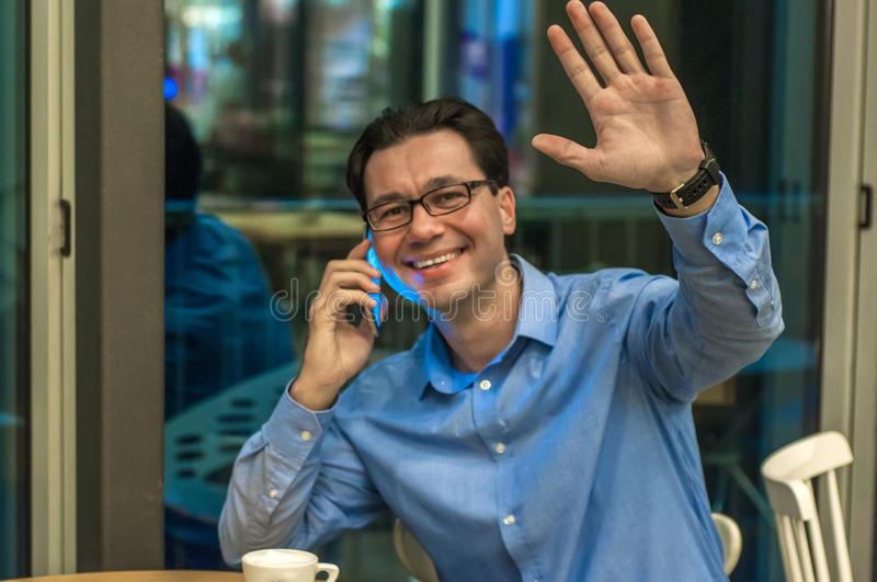 Handsome young successful man doing a welcome gesture. Inviting businessman.Hello I`m Here.  royalty free stock image