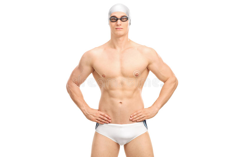 Handsome young swimmer in white swim trunks. And black swimming goggles isolated on white background royalty free stock images