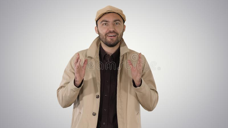 Handsome young thoughtful man has a wonderful idea on gradient background. royalty free stock photography