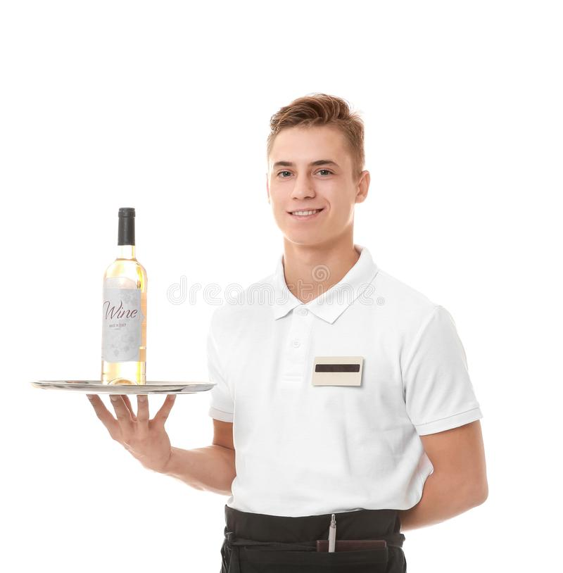 Handsome young waiter holding metal tray with bottle of wine stock photos
