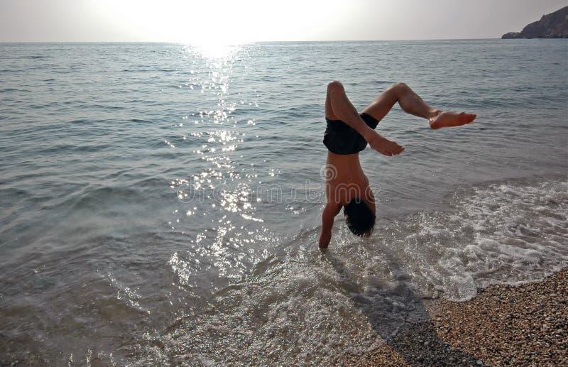 handstand 3 пляжей стоковое изображение