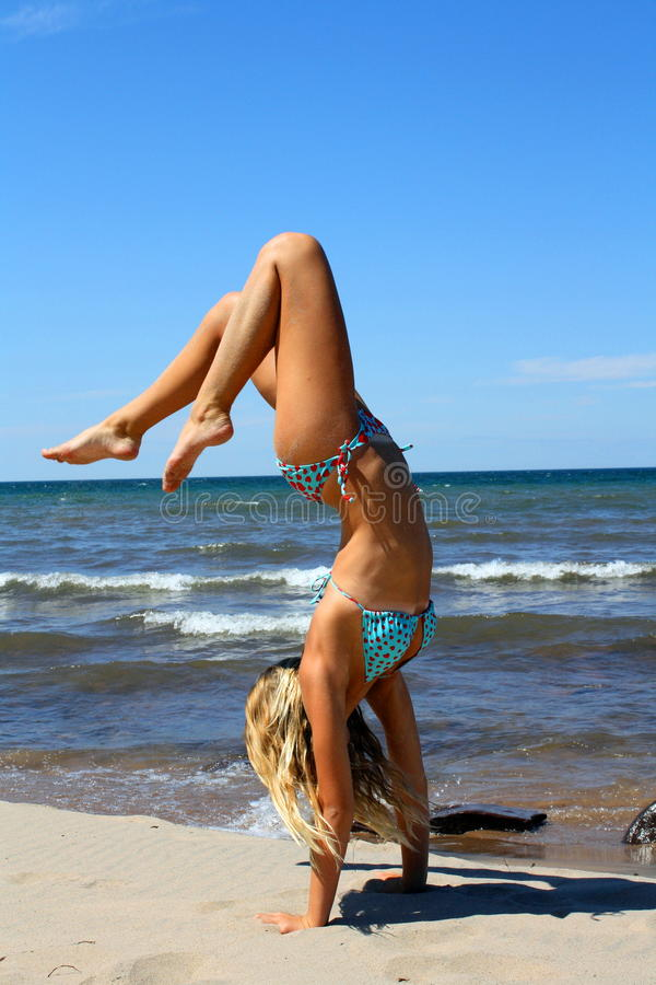 Handstand at the beach stock images