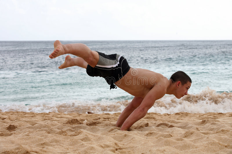 Handstand on the beach stock photo