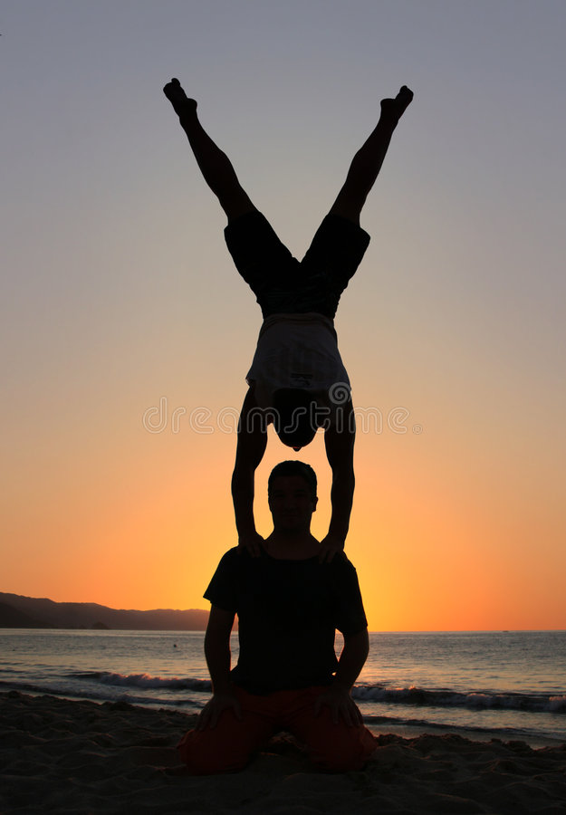 Handstand on the beach stock images
