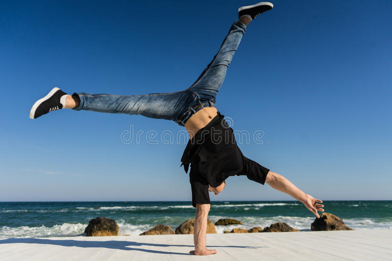Handstand at the beach stock photography
