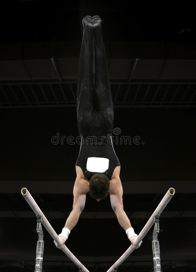 Handstand on parallel bars stock image