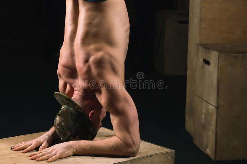 Handstand push-up man workout at gym pus ups. Handstand push-up man on box workout at gym pus ups royalty free stock images