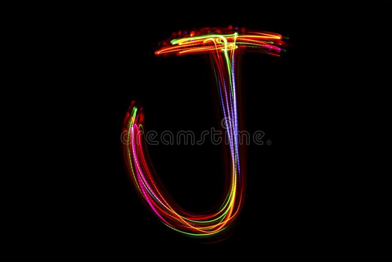 Handstil för ` för ord` J från ljus fotografering för bildbyråer
