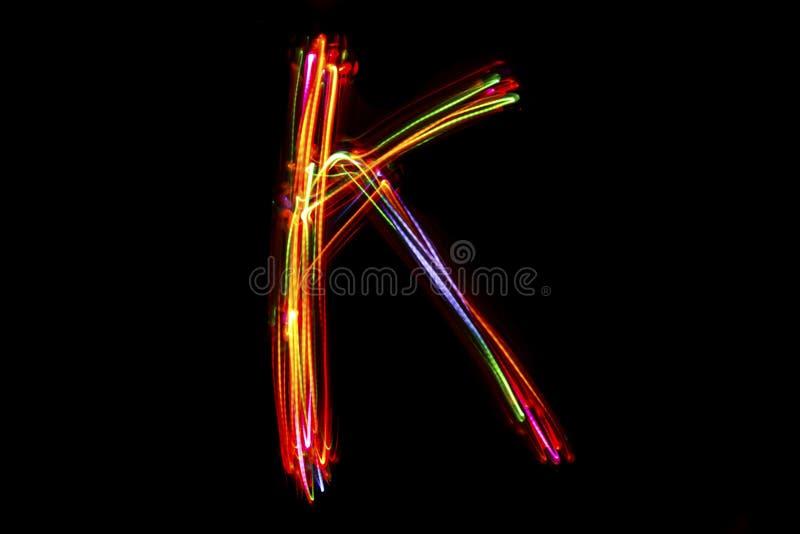 Handstil för ` för ord` K från ljus arkivbilder