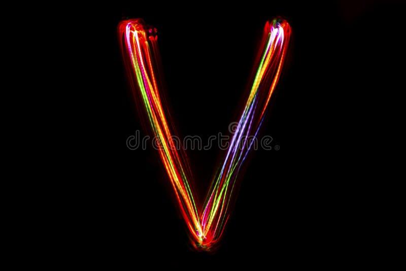 Handstil för ` för ord` V från ljus arkivfoton