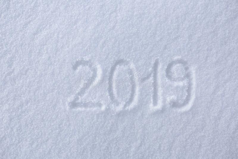 2019 Handstilar på snön lyckligt nytt år Härlig kall solig vinterdag arkivfoto