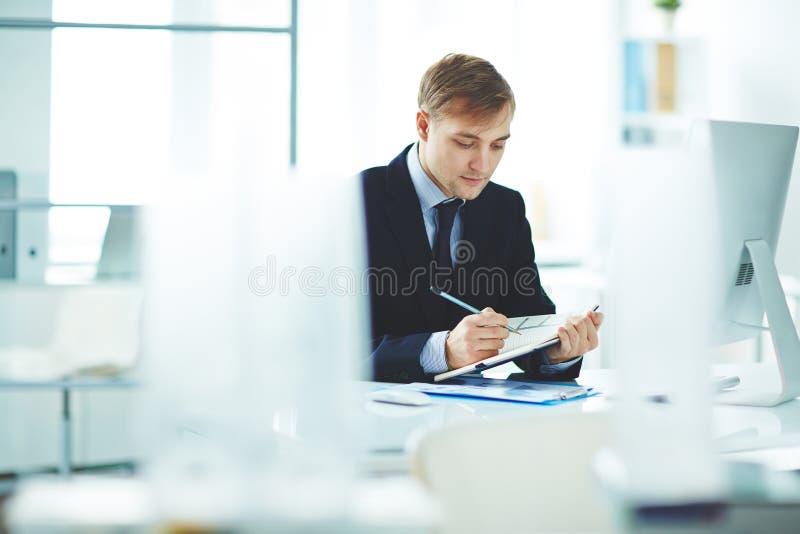 Handstilplan av arbete arkivfoto