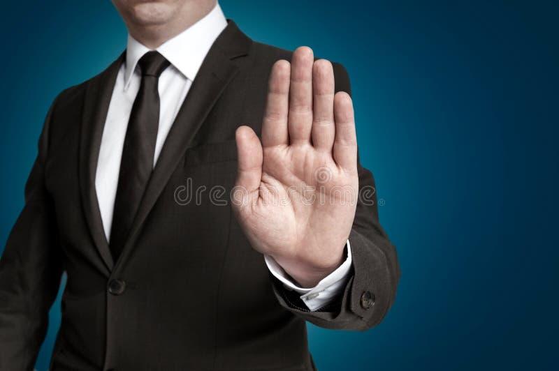 Handstopp som visas av affärsmannen arkivfoto