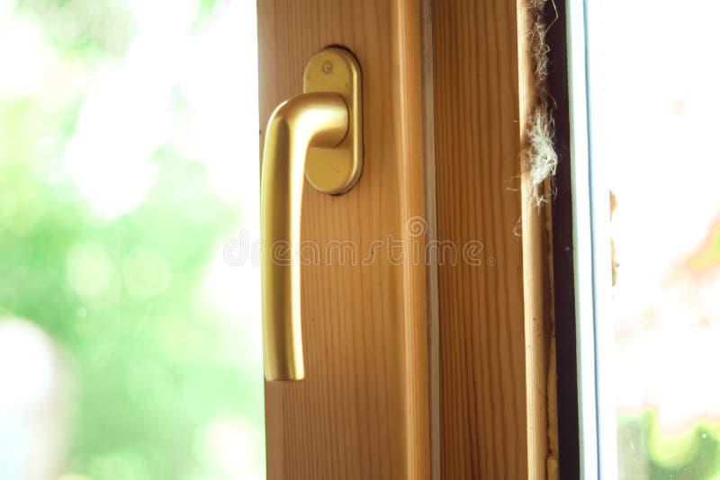 Handtag för fönster arkivfoto