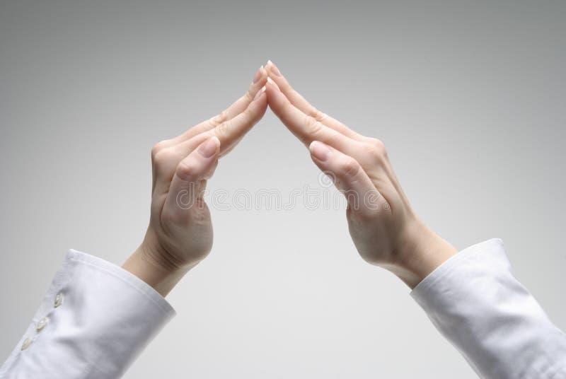 handtak s som visar symbolkvinnan arkivbild