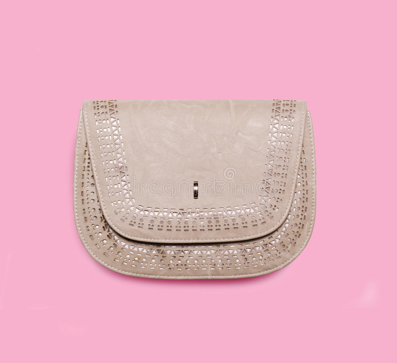 Handtasche auf rosa Hintergrund stockfoto