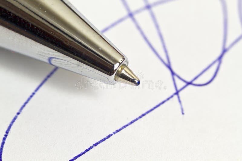 Handtekening en pen stock afbeeldingen