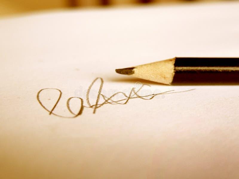 Handtekening in Potlood stock foto