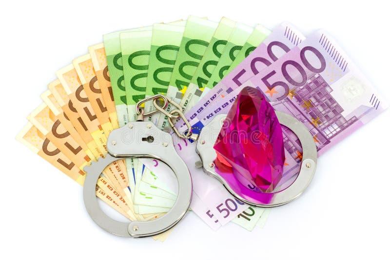 Handuffs, diamante e dinheiro foto de stock royalty free