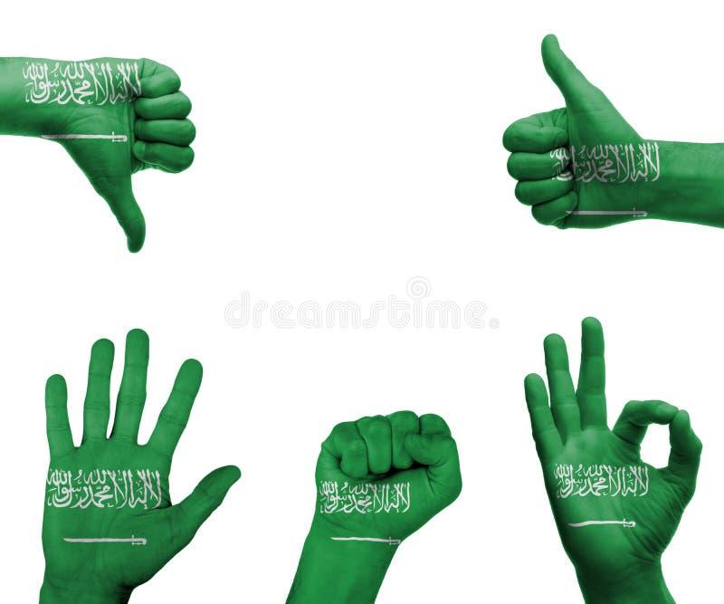 Handuppsättning med flaggan av Saudiarabien royaltyfri bild