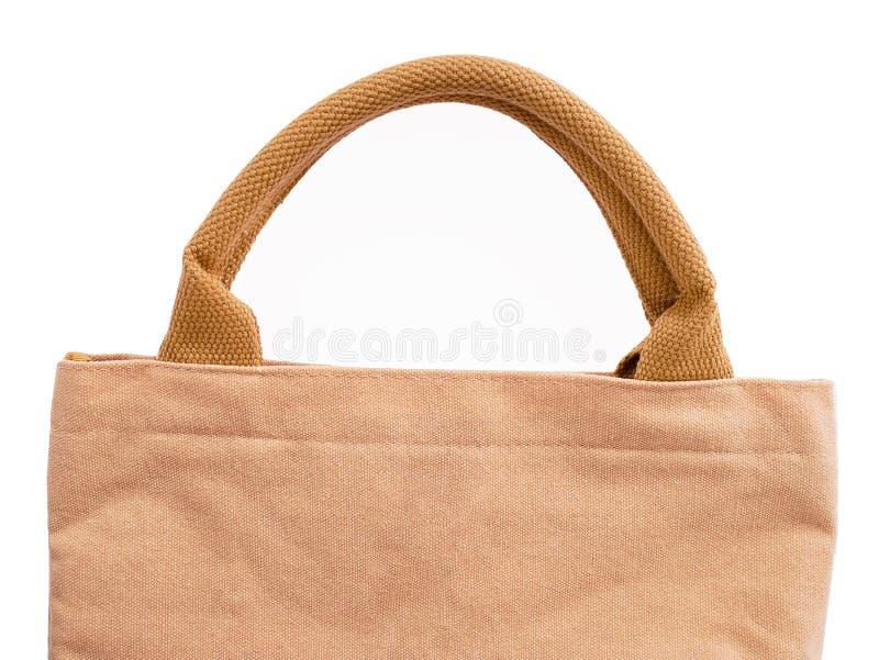 Handväska för kvinna` s från den bruna säckvävtygtextilen som isoleras på den inklusive snabba banan för vit bakgrund arkivfoto
