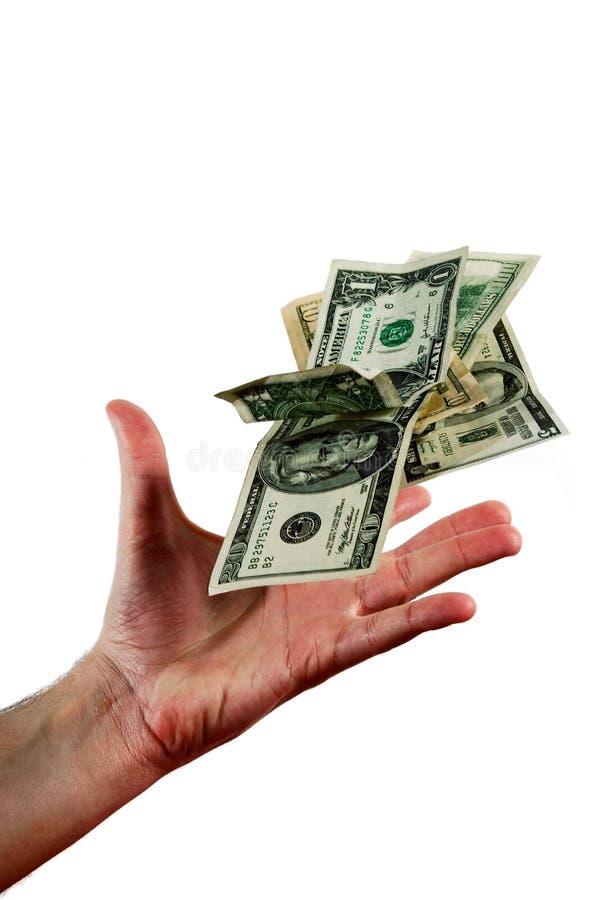 Handwerfendes Geld stockfoto